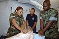 US Navy 070711-N-0989H-058 Hospital Corpsman 1st Class Charles Givens, Task Group 40.9 independent duty corpsman, demonstrate the proper procedures for providing CPR.jpg
