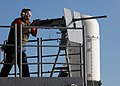 US Navy 070719-N-7981E-237 Aviation Ordnanceman Airman Jason Rowe fires a .50-caliber machine gun from the fantail of Nimitz-class aircraft carrier USS Abraham Lincoln (CVN 72) during a graded, live-fire killer barrel exercise.jpg