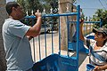 US Navy 070719-N-9421C-148 Hospital Corpsman 3rd Class Steven Kregel, attached to Marine Logistics Group Hawaii, paints a gate at Mother's Love Clinic.jpg