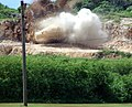 US Navy 071130-N-7367K-002 U.S. Naval Mobile Construction Battalion (NMCB) 1, Guam Det., performs the first rock blast of their deployment at the Orote Point rock quarry on board Naval Base Guam.jpg