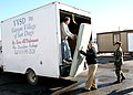 US Navy 071203-N-6357K-103 Chief Engineman James Harmon, leading chief petty officer of 1st Lieutenant Department on board Naval Base Point Loma, helps unload bed supplies at the Veterans Village of San Diego.jpg