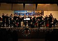 "US Navy 071210-N-9860Y-002 Navy Band Northwest (NBNW) Big Band, ""Cascade"", plays ""Holly and the Ivy - God Rest Ye Merry Gentlemen"" at the ""Holly, Jolly Holiday"" concert held in Parker Hall of Oak Harbor High School.jpg"