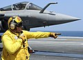 US Navy 080720-N-7571S-010 Chief Warrant Officer 3 Patrick Halinski gives control to a shooter launching a French F-2 Rafale during combined French and American carrier qualifications aboard the aircraft carrier USS Theodore Ro.jpg