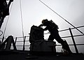 US Navy 080819-N-0807W-152 A Sailor wearing a self-contained breathing apparatus opens a scuttle.jpg