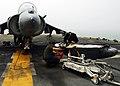 US Navy 080915-N-2183K-006 Marines clean and inspect the 25mm cannon of an AV-8B Harrier jet aboard the amphibious assault ship USS Peleliu (LHA 5).jpg