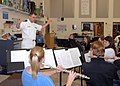 US Navy 080923-N-4649C-007 Lt.j.g. Patrick Sweeten conducts a music class at McNary High School.jpg