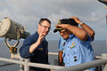 US Navy 081020-N-1635S-014 Lt. Cmdr. Douglas Meagher, acting executive officer of the Ticonderoga-class guided-missile cruiser USS Chancellorsville (CG 62), speaks with Indian Navy sailors outside the ship's pilot house.jpg