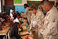 US Navy 090402-N-1057H-113 Seabees assigned to Naval Mobile Construction Battalion (NMCB) 11, Detachment Horn of Africa, share homemade food and other snacks with students.jpg