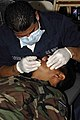US Navy 090622-A-1786S-043 A hospital corpsman aboard the Military Sealift Command hospital ship USNS Comfort (T-AH 20) cleans teeth for a Salvadoran military service member at a medical site during a Continuing Promise 2009 me.jpg