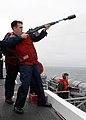 US Navy 090724-N-2600H-009 Gunners Mate 3rd Class Nathan Brassmassery fires a shot line from the flight deck of the aircraft carrier USS Nimitz (CVN 68) to the Military Sealift Command fleet replenishment oiler USNS Yukon (T-AO.jpg