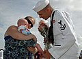 US Navy 090828-N-5292M-521 Damage Controlman 2nd Class Jeff McClure, assigned to the guided-missile destroyer USS Laboon (DDG 58), greets his 5-month-old son for the first time at Naval Station Norfolk, Va.jpg