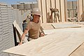 US Navy 090925-N-9623R-005 Builder 1st Class Russell Rea, assigned to Naval Mobile Construction Battalion (NMCB) 22, works on a construction project with the U.S. Army 4th Engineer Battalion.jpg
