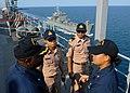 US Navy 100203-N-6692A-159 Electronics Technician 2nd Class Bounthome Khattiya translates for Royal Thai Navy officers.jpg