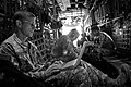 US Navy 100315-N-1928O-009 U.S. Army Gen. Stanley A. McChrystal, commander of the NATO International Security Assistance Force and U.S. Forces-Afghanistan, works on a Lockheed C-130 Hercules aircraft.jpg