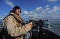 US Navy 100422-N-4965F-218 Gunner's Mate 2nd Class Ian Unterbrink, assigned to a boat detachment of Maritime Expeditionary Security Squadron (MSRON) 3, mans an M2HB .50-caliber machine gun.jpg