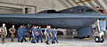 US Navy 100528-N-8433N-752 Sailors assigned to the submarine tender USS Frank Cable (AS 40) and Naval Mobile Construction Battalion (NMCB) 11 walk through the final leg of the tour of a B-2 Spirit at Andersen Air Force Base.jpg