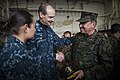 US Navy 100719-N-5319A-428 Capt. Peter Brennan, commodore of Amphibious Squadron (PHIBRON) 5, greets Rear Adm. Luis Ramos, the Peruvian marine commandant, in the hanger bay of the amphibious transport dock ship USS New Orleans.jpg