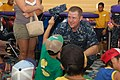 US Navy 100821-N-2729A-004 Lt. j.g. Michael Anderson loses his cover while playing with a child from Fujisawa City's Misono Orphanage during a community relations event.jpg
