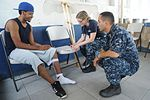 US Navy 100822-N-9964S-104 Lt. Cmdr. Erin Larkins and Hospital Corpsman 2nd Class Victor Montoya-Amaya examine a Costa Rican citizen with a leg-injury.jpg