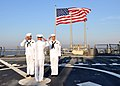 US Navy 101012-N-5292M-790 Sailors conduct morning colors aboard the guided-missile destroyer USS Cole (DDG 67) on the tenth anniversary of the ter.jpg