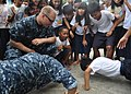 US Navy 101013-N-3620B-094 Aviation Boatswain's Mate (Fuel) Airman Adam Pond oversees a push-up contest.jpg