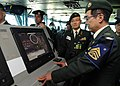 US Navy 101109-N-7191M-036 Members of the Japan Ground Self-Defense Force observe navigation equipment on the navigation bridge aboard the aircraft.jpg