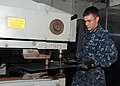US Navy 101116-N-5620H-021 Hull Maintenance Technician Fireman Daniel M. Pope cuts out a piece of sheet metal with a pull max press aboard the subm.jpg
