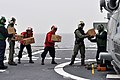US Navy 110320-N-SF508-107 Sailors aboard the Ticonderoga-class guided-missile cruiser USS Shiloh (CG 67) load boxes of Meals Ready-to-Eat onto an.jpg