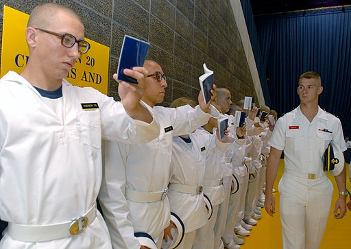 US Navy 110630-N-AC575-005 An upper class midshipman supervises as plebes study Reef Points
