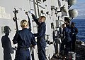 US Navy 111114-N-RI884-178 Sailors aboard the guided-missile destroyer USS O'Kane perform maintenance off the coast of Hawaii during the integrated.jpg