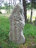 This runestone, U 194, in memory of a Viking known as Alli, says he won Knútr's payment in England.