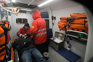Ukrainian Red Cross Society volunteers administering first aid to a wounded Euromaidan protester. Events of Jan 19, 2014-7.jpg