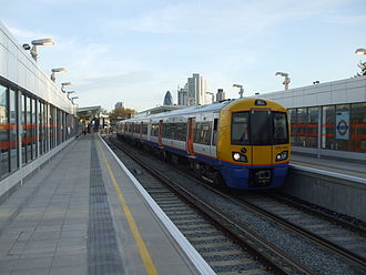 Hoxton railway station - A London Overground train bound for Dalston Junction arrives at the northbound platform.