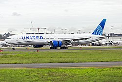 United Airlines (N2250U) Boeing 777-322ER landing at Sydney Airport.jpg