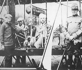 134th Fighter Squadron - Vermont Governor Charles W Gates examines a Vermont National Guard airplane at Fort Ethan Allen in 1915. At his left is VT Adjutant General BG Lee S Tillotion