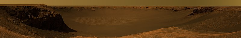This approximate true-color image, taken by the Mars Exploration Rover Opportunity, shows the view of  Victoria Crater from Cape Verde.  It was captured over a three-week period, from October 16 - November 6, 2006.