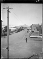 View of Opotiki township, looking along Church Street, circa 1928. ATLIB 291175.png