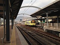 View of platforms of Matsuura Railway from JR platform of Sasebo Station.JPG