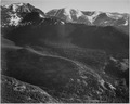 "View of wooded hills with mountains in background, ""In Rocky Mountain National Park,"" Colorado., 1933 - 1942 - NARA - 519961.tif"