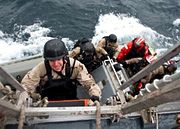 Visit board search and seizure VBSS team