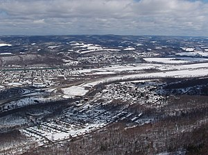 West Branch Susquehanna Valley - The West Branch Susquehanna Valley looking north from above the Bald Eagle Mountain ridge. The village of Castanea is in the foreground at the foot of the ridge. Bald Eagle Creek is in front of Lock Haven and the William T. Piper Memorial Airport, with the West Branch Susquehanna River behind. The foothills below the Allegheny Front are in the background.