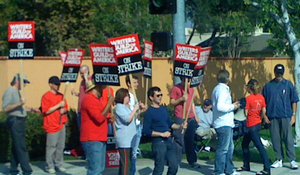 Meet Kevin Johnson - WGA members protest by the lot of Disney, the company that owns ABC.