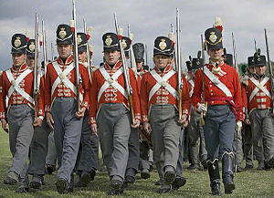 "Shako - Reenactment of British infantry of 1815, with line infantry wearing the Belgic shako, followed by light infantry wearing the earlier, ""stovepipe"" style."