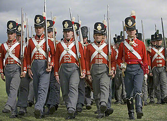 Duke of Wellington's Regiment - Reenactors in the red-coated uniform of the 33rd Regiment of Foot as worn during the Napoleonic Wars between 1812 and 1816. Note the brighter scarlet of the officer on the right.
