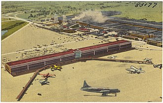 Willow Run Airport - Postcard showing the Willow Run terminal, with the former bomber plant in the right background (ca. 1946-1955)