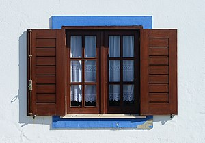 Window - Window of traditional design in Porto Covo, Portugal