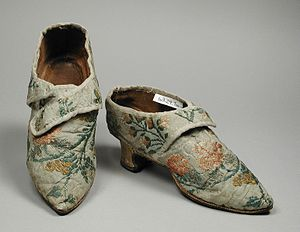 1775–95 in Western fashion - Woman's silk brocade shoes with straps for shoe buckles, 1770s. Los Angeles County Museum of Art, 63.24.7a-b.
