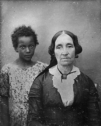 Slavery - Portrait of an older woman in New Orleans with her enslaved servant girl in the mid 19th century