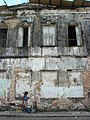 Woman Walks Past Weathered Facade in Santo Amaro - Bahia - Brazil.jpg