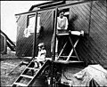 Woman washing outside caravan (6537928805).jpg